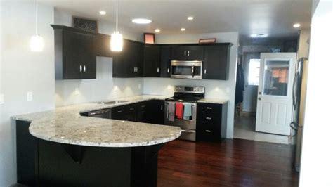 Espresso cabinets, dark hardwood floors, Alaskan white
