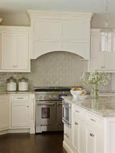 Backsplash In White Kitchen Off White Cabinetry Paired With A Glossy Neutral Tile