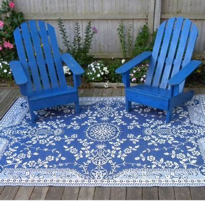 go outdoors rugs this would go with the trailer graphic and the white adirondack chairs the right blue not
