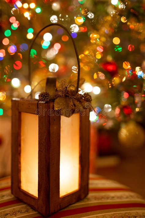 christmas lantern with magic warm lights in the background