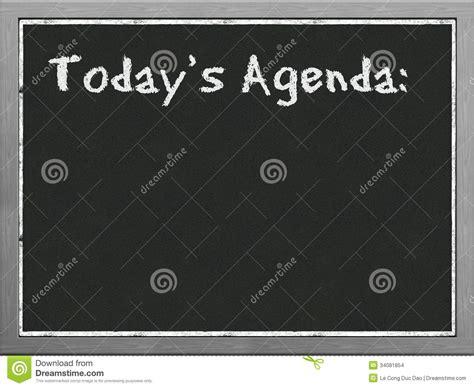 black board showing agenda stock images image