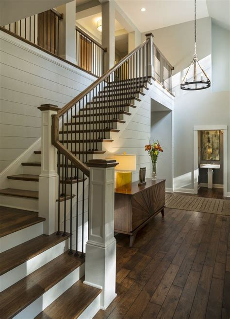 stair case entryway with rustic wood floors l shaped stairway