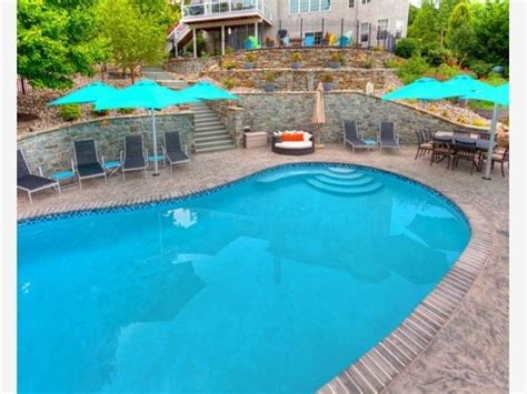 beautiful backyard swimming pools beautiful backyard pool with a tiered wall off of the
