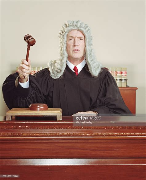 judges on judging views from the bench judge sitting at bench holding gavel stock photo getty