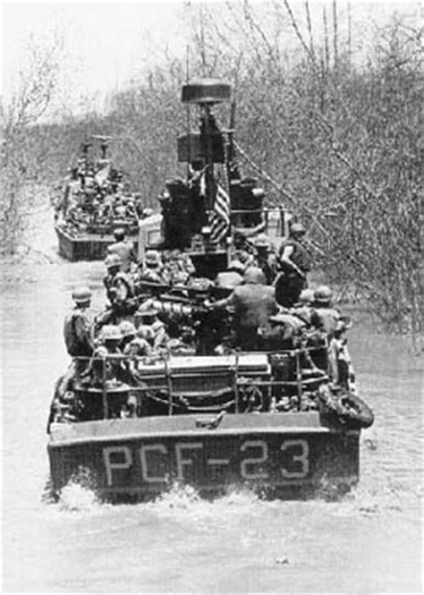 a boat operating in a narrow channel vietnam river war