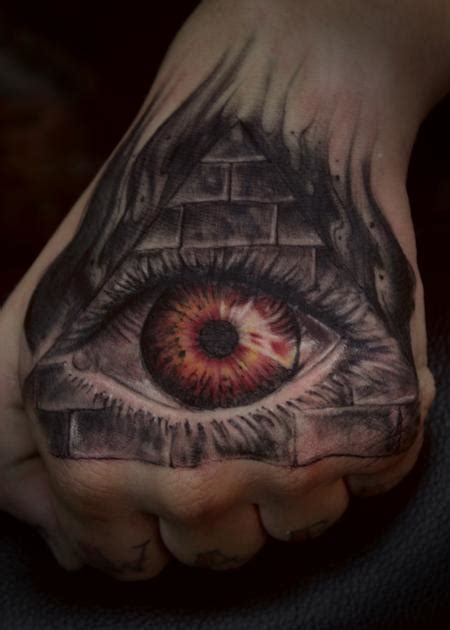hand eye tattoo illuminati by steve phipps tattoonow