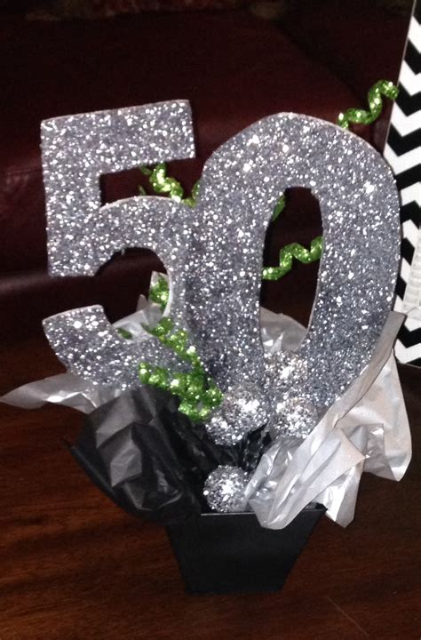 sparkly silver 50th birthday centerpiece follow us