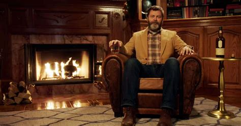nick offerman drinking whiskey nick offerman silently drinking whiskey by a fireplace for