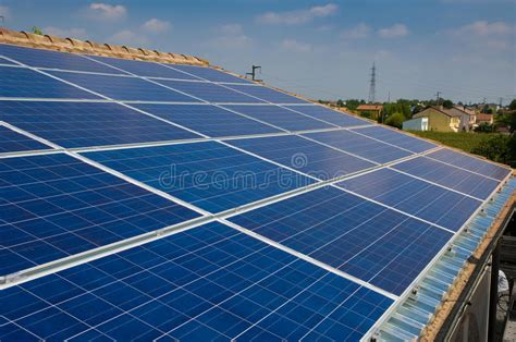 solar panel on a house roof green energy from sun royalty