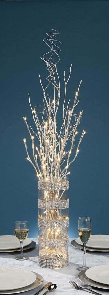 27 inch silver glitter branch with 20 warm white led