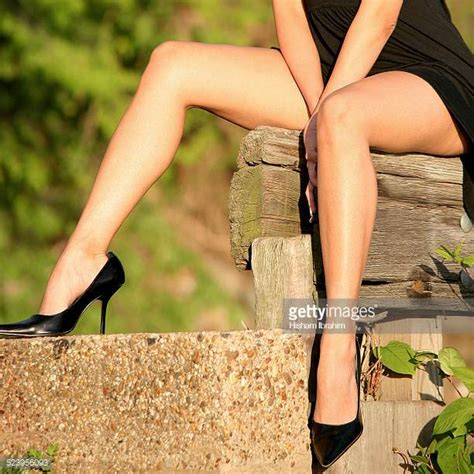 legs in high heels legs and skirt sitting stock photos and