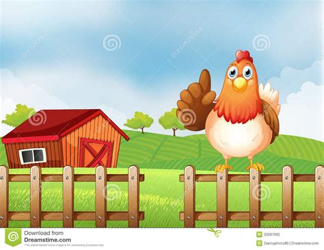 Two Story Barn House a chicken above a wooden fence at the farm stock