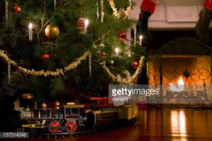 toy train under the christmas tree stock photo getty images