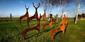 Metal deer garden sculptures created by garden art and sculpture