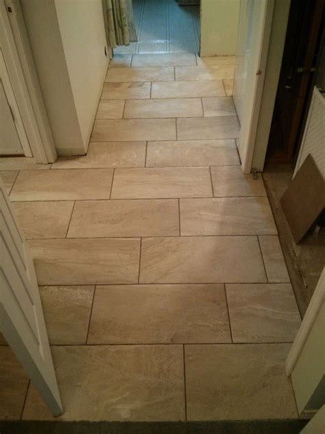 brick pattern tile on floor 12x24 porcelain tile basement entry and hallway good