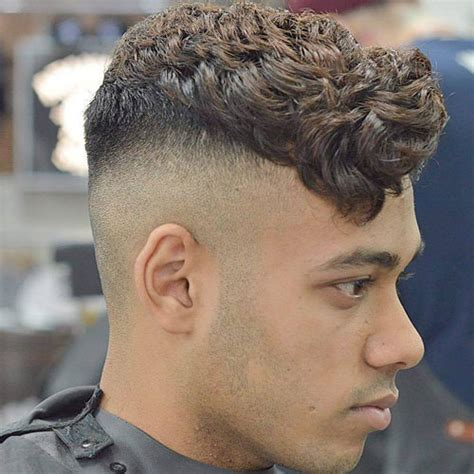 short curly top hair with straight sides shaved sides hairstyles for men