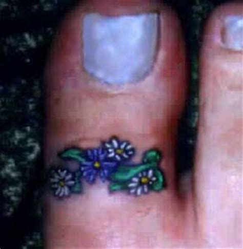 flower tattoo ring small bunch of flowers on big toe tattooimages biz