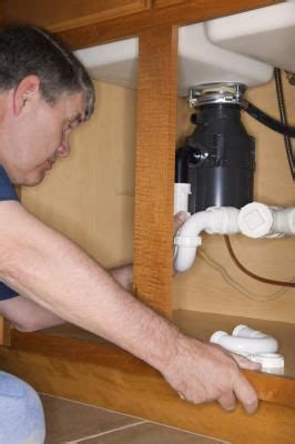 kitchen sink backs up into other side how to stop disposal from backing up into other sink