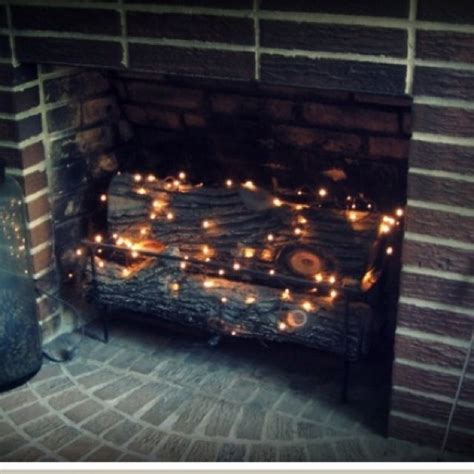 Fireplace Lighted Logs by 25 Best Ideas About Fireplace On