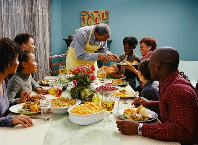 family eating thanksgiving dinner umoja karamu giving thanks to afrikan culture kushite