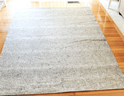 how to choose a rug pad choosing a rug pad for your floors at home with zan
