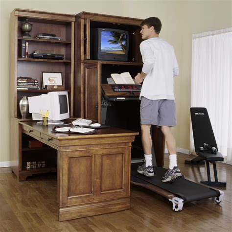 treadmill armoire the treadmill armoire cabinet hammacher schlemmer