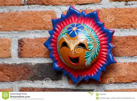 mexican handcraft sun face made of clay stock photo