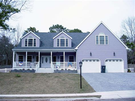 Garage Plans With Porch by Cape Cod Style Home With Farmers Porch Two Car Garage And