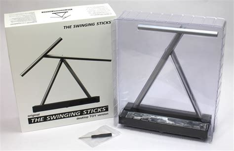 swinging sticks kinetic desk sculpture buy the swinging sticks kinetic sculpture online at jp