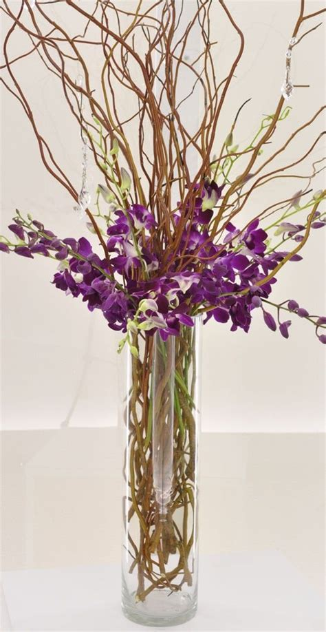 cylinder vase with curly willow with purple