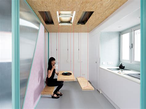 Pull Ceiling Storage by A Teeny House Filled With Clever Space Saving