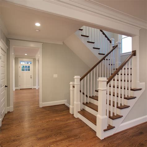 U Shaped Stairs Design The Beautiful U Shaped Stair Has Hardwood Treads And Handrails With Painted White Risers Newel