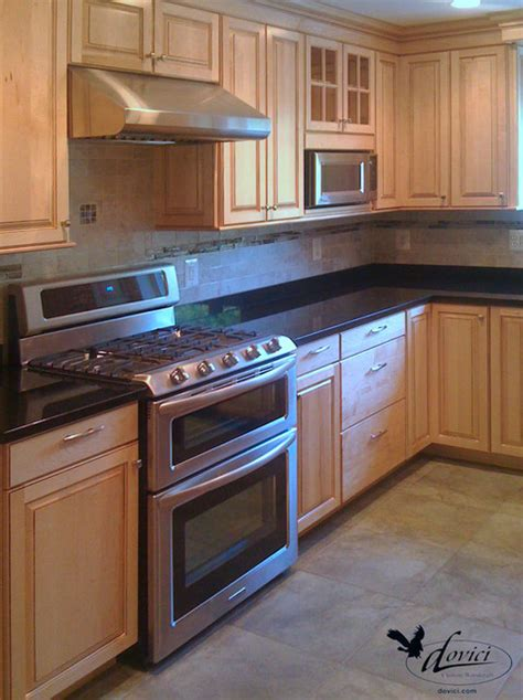 kitchen contrasting sand colored cabinets and black