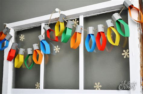 christmas decoration useing construction paper paper lights garland tutorial stubbornly crafty