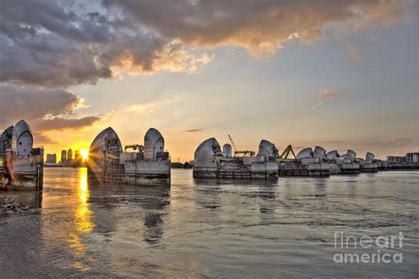thames barrier september thames barrier and canary wharf in london photograph by