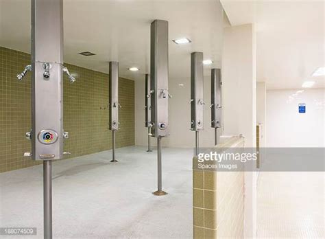 locker room showers locker room shower stock photos and pictures getty images