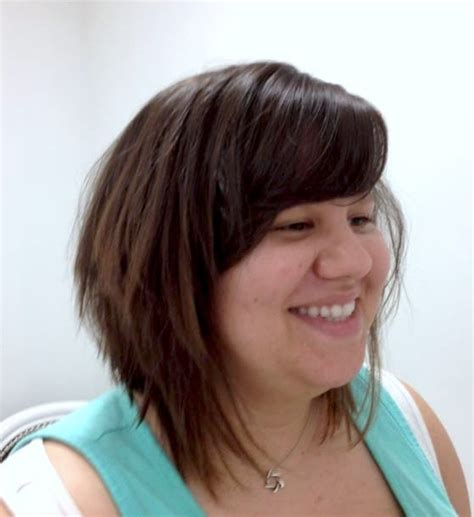 aline bob with sideswept bangs a line bob with side sweeping bangs styled tousled look