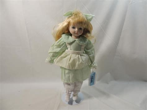 porcelain doll green dress porcelain doll in light green dress with stand