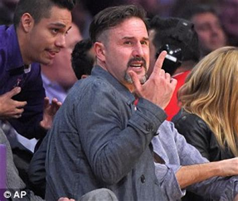 Arquette Barely Keeps The In At A Scottish Fashion Event by David Beckham And Best Friend Dave Gardner Sit Courtside