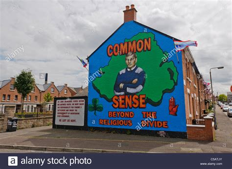 houses to buy in belfast mural in belfast quot common sense beyond the religious divide quot with stock photo royalty