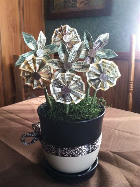 Origami Flowers Made From Money - 25 best ideas about money flowers on money