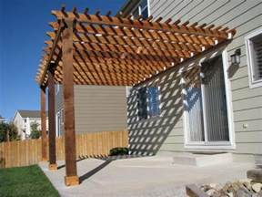 Simple pergola attached to the house nice color not to complex or
