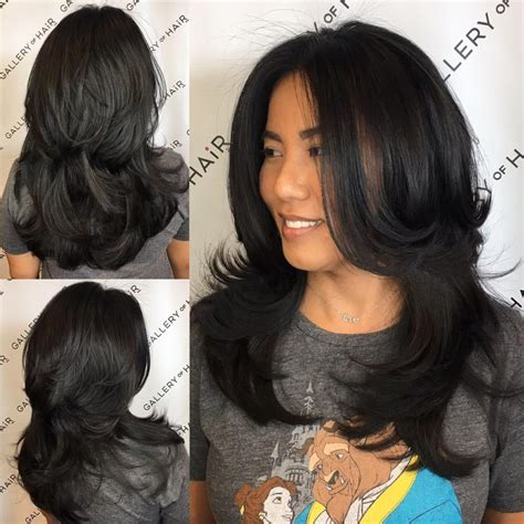 pictures of very long hair flipped at ends women s black shaggy razor cut with long layers and
