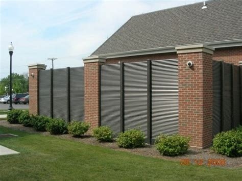 Modern Brick Wall by Aluminum Fence Ametco Manufacturing
