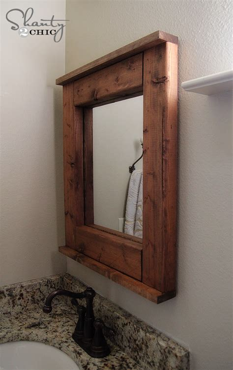 how to frame a bathroom mirror with wood wood mirror diy shanty 2 chic