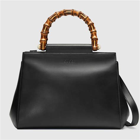 Guci Leather gucci nymphaea leather top handle bag gucci s