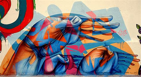 Painting A Mural On A Wall With Acrylic Paint brazilian graffiti artist lelin alves combines abstract
