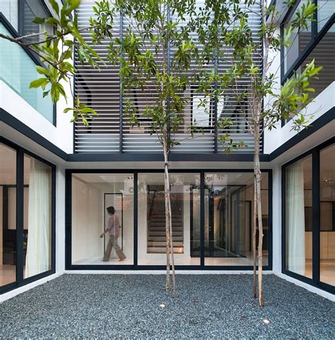 interior courtyard clever use of louvers and a neutral color scheme transform