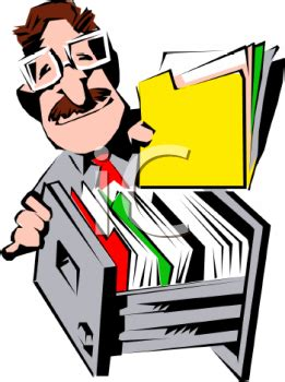 Office Worker Putting a File in a Filing Cabinet   Royalty