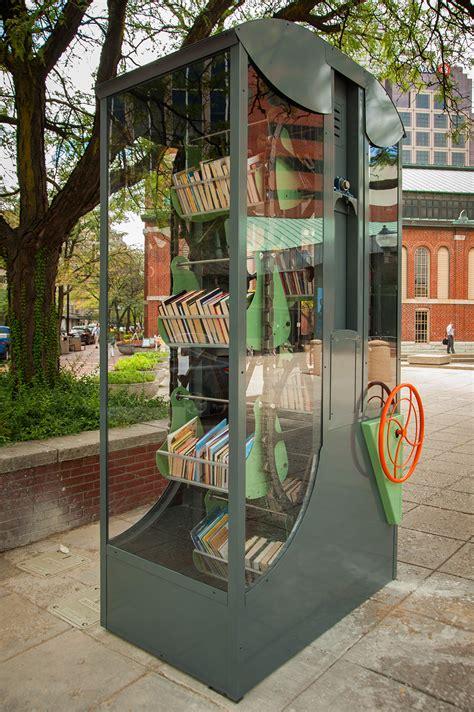 artist designed miniature book sharing libraries